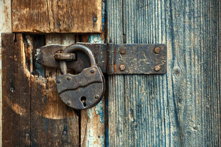 Photo for Old master lock pad locked on wooden door. - Royalty Free Image