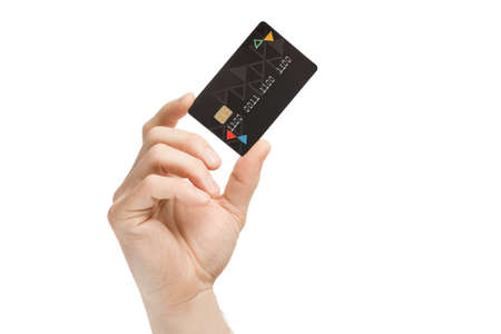 Photo pour Close up of a hand holding a black credit card on a white background. Focus on the card. - image libre de droit