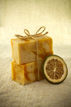 Natural handmade soap and dry lemon,  isolated on a white background.