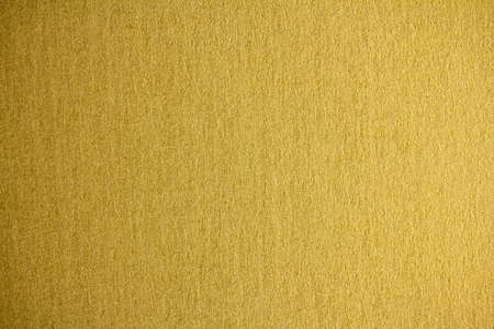 Gold wallpaper background, studio photography.