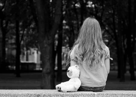 Young girl sitting in a park  Black and white photography の写真素材