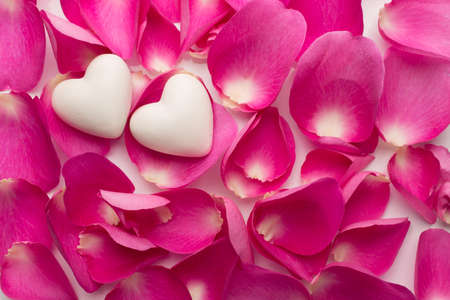 Rose petals and stone hearts.