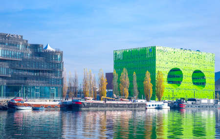 Lyon,  France - December 9, 2016: Confluence district, the Green Cube building on the Saone river bank