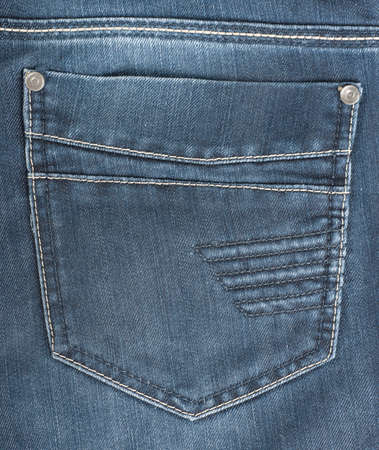The background of the back pocket of blue jeans