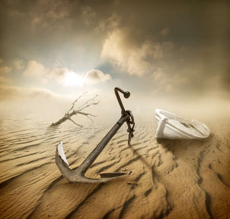 Boat, anchor and dry tree in the desert