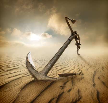 Anchor in the desert and cloudy sky