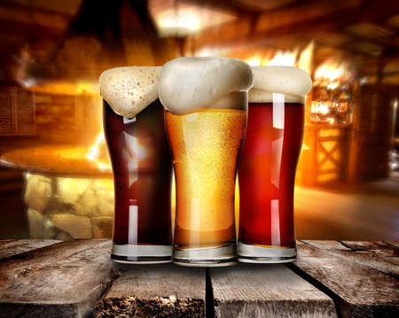 Photo for Three glasses of beer on a table in bar - Royalty Free Image