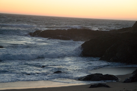 Rocky calm ocean at sunset