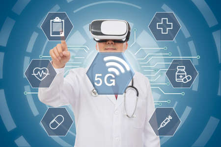 Foto de Male doctor wearing virtual reality glasses. 5G Medical Concept. CG - Imagen libre de derechos