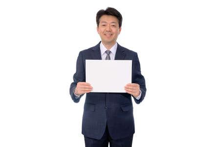 Photo pour Portrait of Asian businessman holding blank message board. - image libre de droit