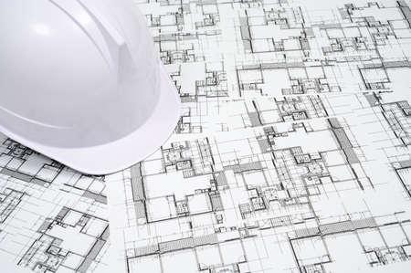 Foto de Construction industry concept with a hard hat on architectural drawing. - Imagen libre de derechos