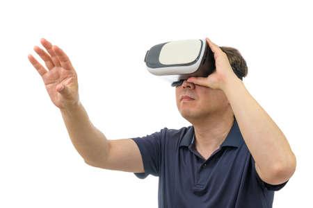 Foto de Man wearing virtual reality goggles. Studio shot, white background. - Imagen libre de derechos