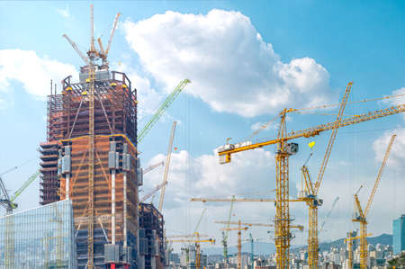 Photo for Panorama with many tower cranes in clear blue sky with clouds. - Royalty Free Image