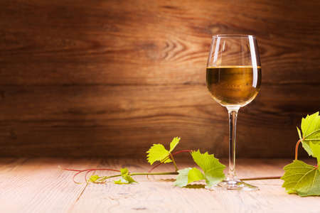 Photo for Glass of white wine on a wooden background - Royalty Free Image