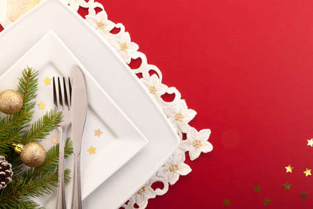 Christmas place setting with ribbon and christmas decorations