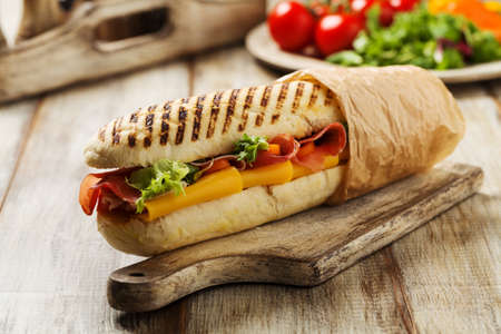 Photo pour Traditional Italian sandwich with ham and cheese served warm. - image libre de droit