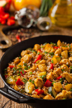 Photo for Buckwheat with chicken and vegetables. Front view. - Royalty Free Image