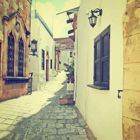Narrow Alley with Old Buildings inl Greek City, Retro Effect