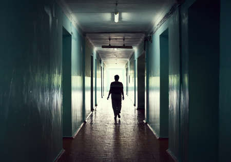 silhouette in a corridor. Light at the end of the tunnel concept