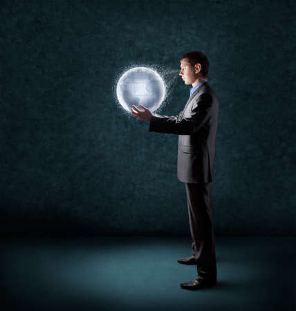 Photo pour  businessman holding glowing planet earth  - image libre de droit