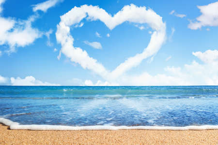 beach and sea. Heart of clouds on sky. Symbol of love