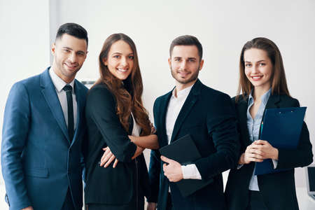 Photo for Group of young and smiling business people in modern office - Royalty Free Image