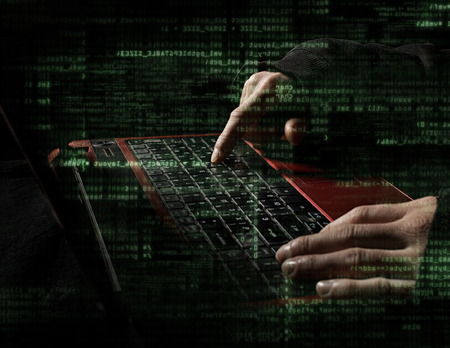 Silhouette of a hacker uses a command on graphic user interface