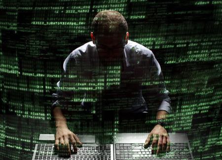 Photo pour Silhouette of a hacker uses a command on graphic user interface  - image libre de droit