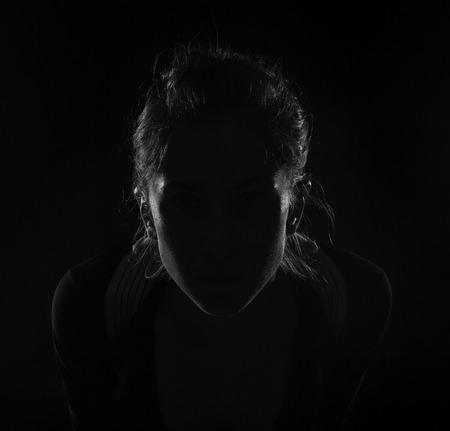 Photo pour Hidden face in the shadow. female silhouette. - image libre de droit