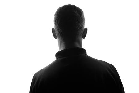 Photo pour Male person silhouette,back lit over white - image libre de droit