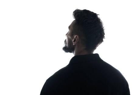 Photo pour Silhouette of male person , back view back lit over white  - image libre de droit