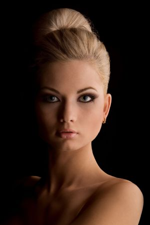 Portrait of gorgeous woman. Portrait of gorgeous blond woman against black backgroundの写真素材