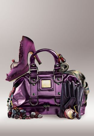 Purple purse and shoes. A background of purple shoes, purse and accessories.