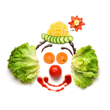 Foto de Happy meal for opponents of fast-food  A nice and funny edible clown, made of strawberries, lemons, salad and so on  - Imagen libre de derechos