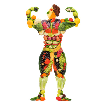 Fruits and vegetables in the shape of a healthy posing muscular bodybuilder