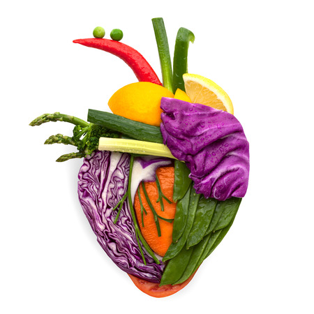 A healthy human heart made of fruits and vegetables as a food concept of smart eating.
