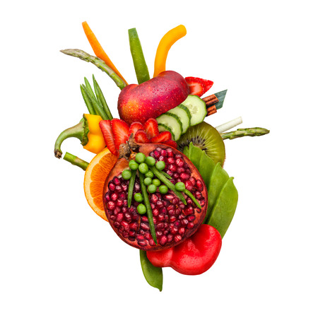 Photo pour Healthy food concept of a human heart made of fruits and vegs that reduce death risk, isolated on white. - image libre de droit
