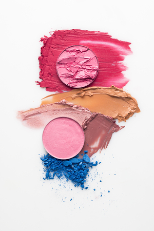 Foto de Creative concept photo of cosmetics swatches on white background. - Imagen libre de derechos