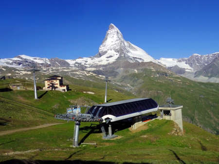 Matterhorn peak with cable car station in Summer. Zermatt, Switzerland green city