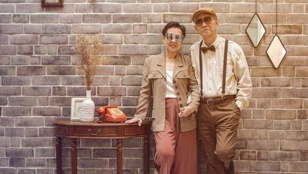 Photo pour Rich Asian senior couple vintage fashion in luxury home - image libre de droit