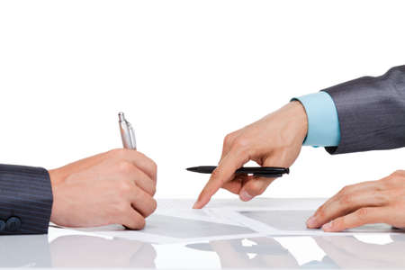 Photo pour Business men hands at the desk over white background - image libre de droit