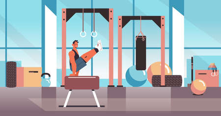 professional gymnast doing physical exercises on pommel horse working out fitness training healthy lifestyle concept