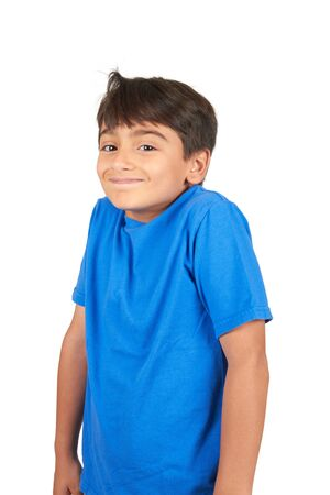 Photo pour School Age Handsome Boy looking at camera isolated on white background - image libre de droit