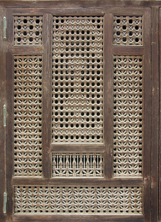 Old wood window or door with islamic mashrabia