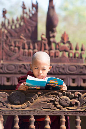 BAGAN, MYANMAR MAR 2: a young novice stydying at Nat Taung Kyaung Monastery on Mar 2, 2015 in Bagan, Myanmar. Boys at 8-20 years old have to enter the Buddhist Order as a novice.