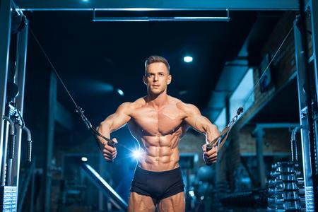 Foto für sportsman with muscular torso has workout in gym; - Lizenzfreies Bild
