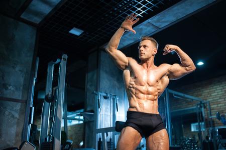 Foto für young bodybuilder shows muscular body; - Lizenzfreies Bild