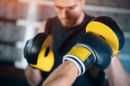 Foto de close up of man boxing sparring or fighting in boxing gloves at ring - Imagen libre de derechos