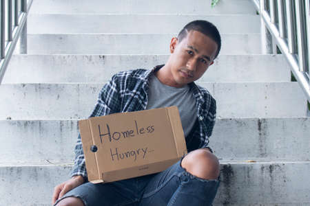 Photo for Unhappy homeless man - Royalty Free Image