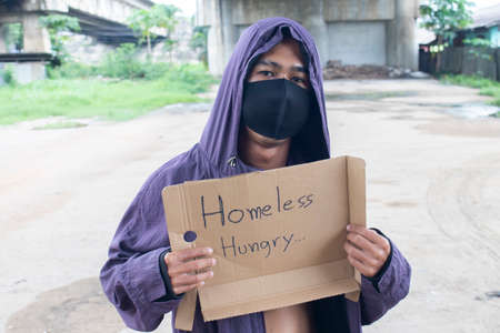 Photo for Unhappy homeless man under the bridge - Royalty Free Image